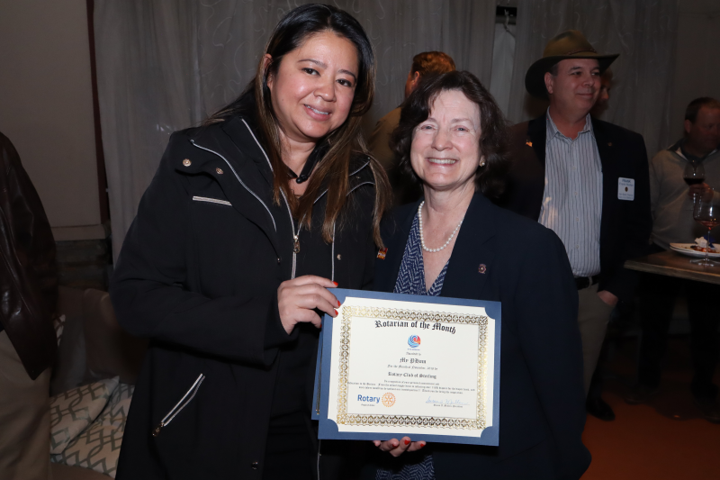 Susan Mullen presenting November Rotarian of the Month to My Pham